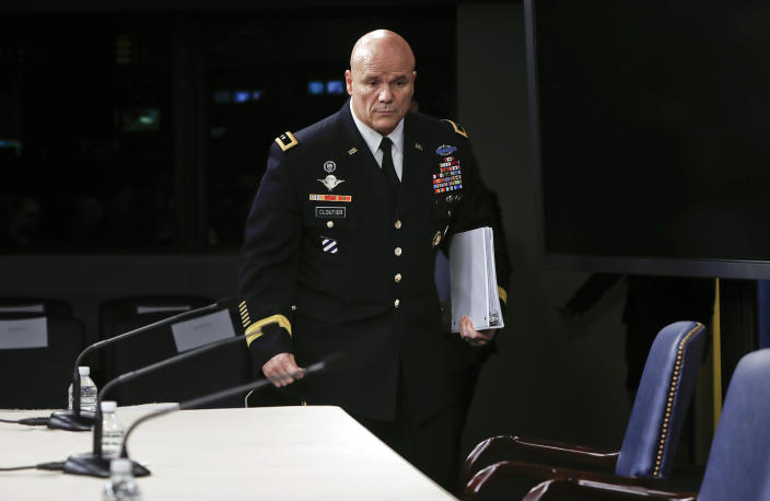 Army Maj. Gen. Roger L. Cloutier, right,  chief of staff, U.S. Africa Command, and lead investigating officer, arrives to brief members of the media at the Pentagon, Thursday, May 10, 2018. (Pablo Martinez Monsivais/AP)