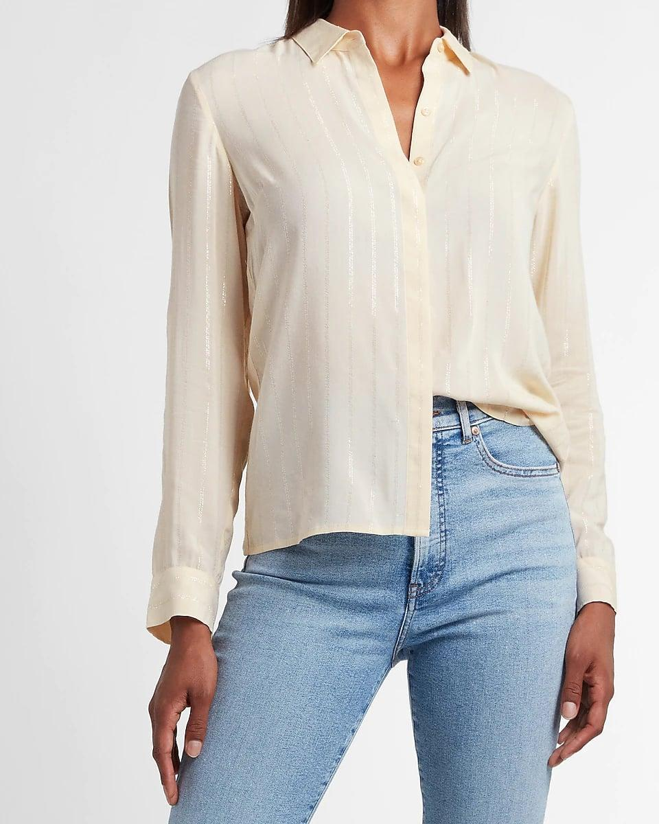 <p>A classic silhouette gets a colorful upgrade with this <span>Express Metallic Striped Portofino Shirt</span> ($54). Tuck it into your favorite jeans on a casual Friday, or pair it with a slip skirt for an even more polished outfit. You can also wear it with a tank top for an easygoing look.</p>