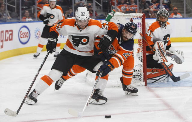 Philadelphia Flyers' Shayne Gostisbehere (53) and Edmonton Oilers' Tobias Rieder (22) battle for the puck as Flyers goalie Anthony Stolarz (41) looks for the shot during second-period NHL hockey game action in Edmonton, Alberta, Friday, Dec. 14, 2018. (Jason Franson/The Canadian Press via AP)