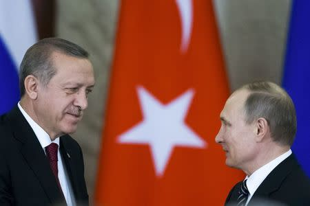 Russian President Putin shakes hands with his Turkish counterpart Erdogan after the talks in Moscow