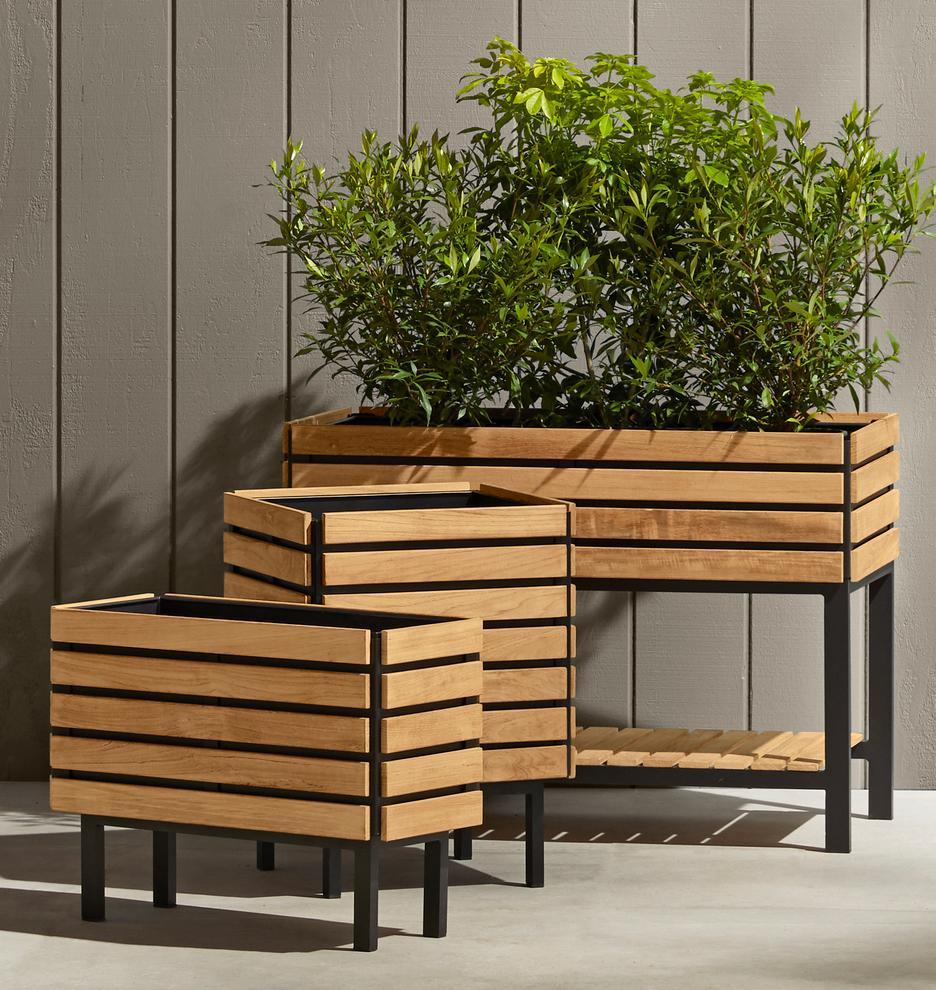 Elevate your plants with these beautiful teak containers. (Photo: rejuvenation)