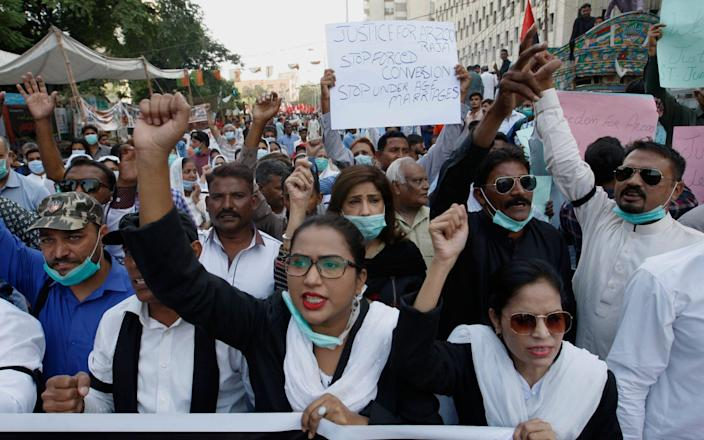 Pakistani Christians protest against child marriage and forced conversion, in Karachi - Fareed Khan/AP