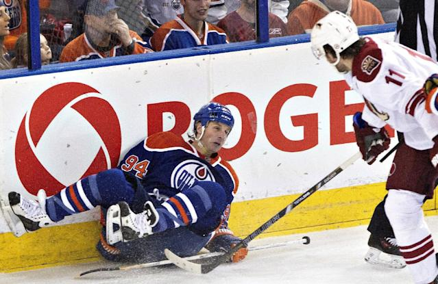Phoenix Coyotes' Martin Hanzal (11) looks over after checking Edmonton Oilers' Ryan Smyth (94) during the first period of an NHL hockey game Friday, Jan. 24, 2014, in Edmonton, Alberta. (AP Photo/The Canadian Press, Jason Franson)