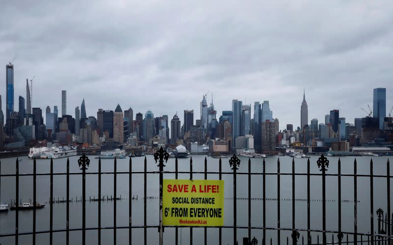 The New York City skyline of Manhattan during outbreak of the coronavirus disease (COVID-19), from Weehawken