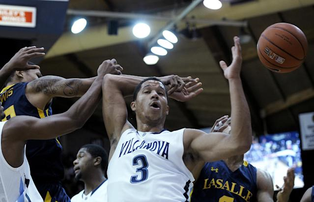 Villanova's Josh Hart (3) reaches for a loose ball in front of La Salle's Khalid Lewis, left, during the first half of an NCAA college basketball game on Sunday, Dec. 15, 2013, in Villanova, Pa. (AP Photo/Michael Perez)