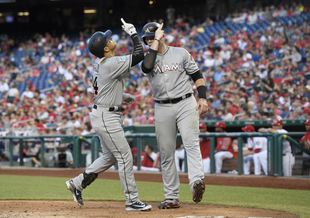 Miami Marlins' Martin Prado, left, celebrates his three-run home run with Justin Bour, right, during the second inning of a baseball game against the Washington Nationals, Thursday, July 5, 2018, in Washington. (AP Photo/Nick Wass)