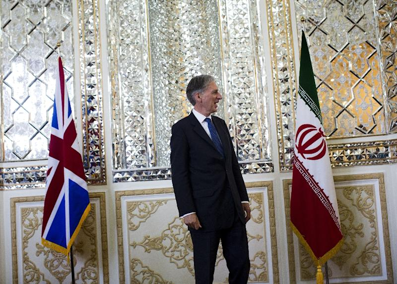 British Foreign Minister Philip Hammond on August 23, 2015, as he reopened his country's embassy in Tehran four years after a mob stormed the compound (AFP Photo/Behrouz Mehri)