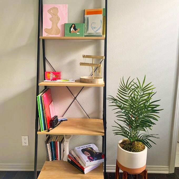 """<h2>Mercury Row Almanzar Metal Ladder Bookcase</h2><br><strong>Deal: 33% Off</strong><br>If our very own <a href=""""https://www.refinery29.com/en-us/what-to-buy-with-100-dollars#slide-16"""" rel=""""nofollow noopener"""" target=""""_blank"""" data-ylk=""""slk:Beauty writer, Karina Hoshikawa, wasn't already an IRL fan of this bestselling bookcase"""" class=""""link rapid-noclick-resp"""">Beauty writer, Karina Hoshikawa, wasn't already an IRL fan of this bestselling bookcase</a>, then we may be skeptical of the near 9,000 reviews praising it as a must-buy piece. With a 4.7-out-of-5-star rating and an unbeatable under-$100 price tag, this organizational system is simple, effective, and looks minimalist chic inside any style space.<br><br><strong>Mercury Row</strong> Almanzar 70.87"""" H x 23.62"""" W Metal Ladder Bookcase, $, available at <a href=""""https://go.skimresources.com/?id=30283X879131&url=https%3A%2F%2Fwww.wayfair.com%2Ffurniture%2Fpdp%2Fmercury-row-almanzar-7087-h-x-2362-w-metal-ladder-bookcase-mcrw7414.html"""" rel=""""nofollow noopener"""" target=""""_blank"""" data-ylk=""""slk:Wayfair"""" class=""""link rapid-noclick-resp"""">Wayfair</a>"""