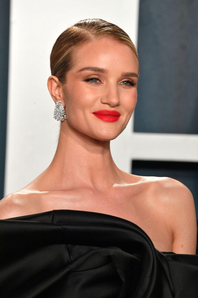 <p>A bold red lip will always be in style. Rosie Huntington-Whiteley's red lip takes center stage while her full lashes and understated eye makeup pull it all together. </p>