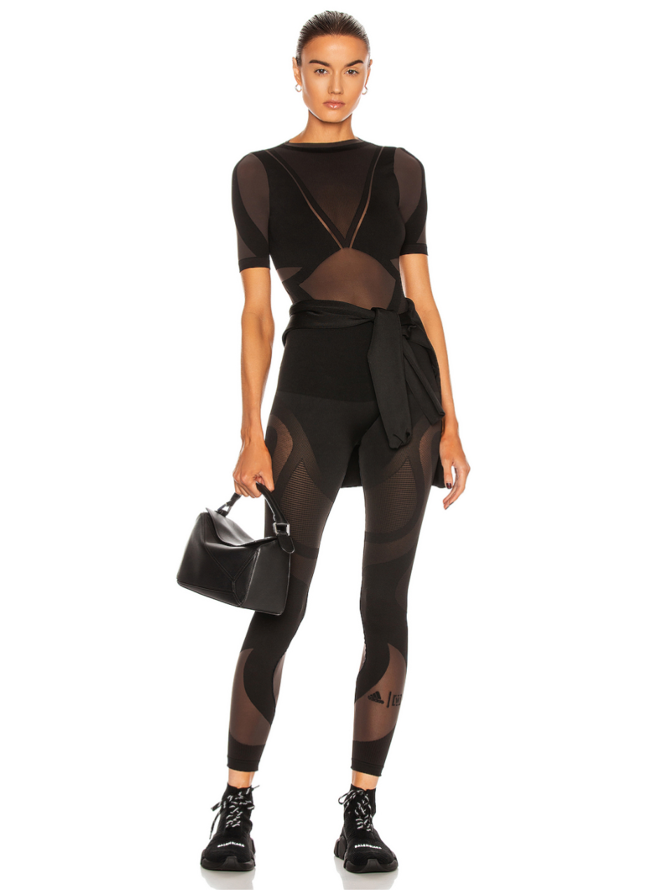 model wearing sheer motion bodysuit and matching leggings by Wolford x Adidas