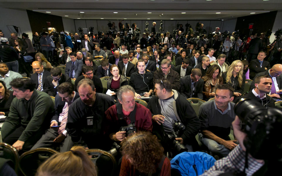 Journalists wait for NBA Commissioner Adam Silver to address a news conference in New York, Tuesday, April 29, 2014. Silver announced that Los Angeles Clippers owner Donald Sterling has been banned for life by the league in response to racist comments the league says he made in a recorded conversation. (AP Photo/Richard Drew)