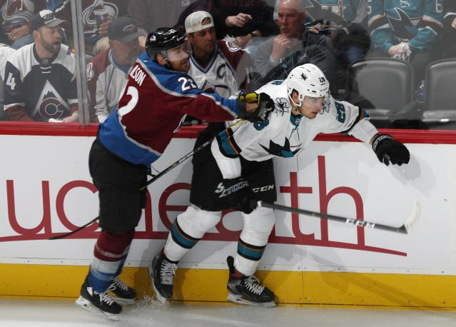 Colorado Avalanche center Colin Wilson, left, checks San Jose Sharks right wing Timo Meier during the first period of Game 4 of an NHL hockey second-round playoff series Thursday, May 2, 2019, in Denver. (AP Photo/David Zalubowski)