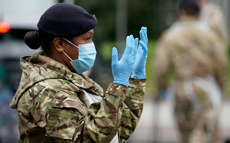 Soldiers from the Royal Logistics Corp operate a mobile coronavirus testing site at Evington Leisure Centre in Leicester - Christopher Furlong/ Getty Images Europe