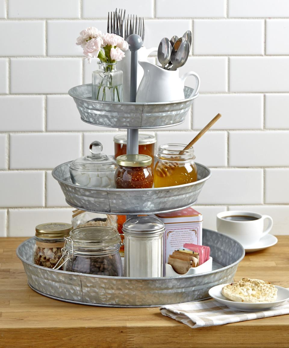 """If you're in a small space, turn to this kitchen stand that can store utensils, spices and other essentials. With three tiers, you'll find you can save lots of room on your countertop. <a href=""""https://fave.co/3m0BjBZ"""" target=""""_blank"""" rel=""""noopener noreferrer"""">Find it for $27 at Walmart</a>."""