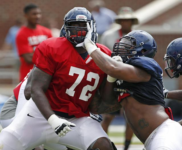 Mississippi defensive tackle Robert Nkemdiche, right, tries to get past offensive lineman Aaron Morris (72) during their final open NCAA college football practice, Saturday, Aug. 9, 2014, in Oxford, Miss. Players were involved in individual and team drills. (AP Photo/Rogelio V. Solis)