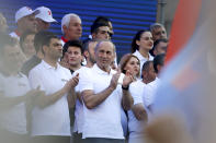 Former Armenian President Robert Kocharyan applauds during a rally of his supporters in Yerevan, Armenia, Friday, June 18, 2021. In Sunday's election, more than 2,000 polling stations will open across Armenia, with nearly 2.6 million people eligible to vote. The ballot includes 21 political parties and four electoral blocs, but two political forces are seen as the main contenders: the ruling Civic Contract party led by Pashinyan and the Armenia alliance, led by former President Robert Kocharyan. (AP Photo/Sergei Grits)