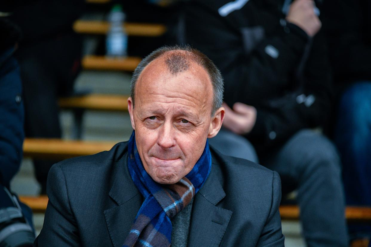 ARNSBERG, GERMANY - APRIL 17: German Christian Democrat (CDU) Friedrich Merz takes part at a gathering at an outdoor stadium to determine the CDU candidate for voting district 147 for the Bundestag during the coronavirus pandemic on April 17, 2021 in Arnsberg, Germany. Merz, who has earned the reputation of a firebrand within the party and recently sought to become party leader, is seeking to replace the district's current MP, Patrick Sensburg. The gathering is taking place at the outdoor stadium due to the pandemic. Germany is scheduled to hold federal elections in September. (Photo by Sascha Schuermann/Getty Images)