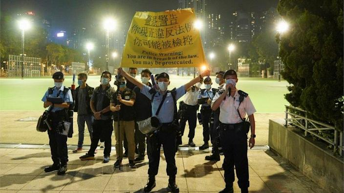 Police officers guard in Victoria Park, Hong Kong