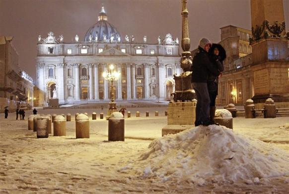 A couple hugs during a heavy snowfall at Saint Peter's Square at the Vatican February 10, 2012.