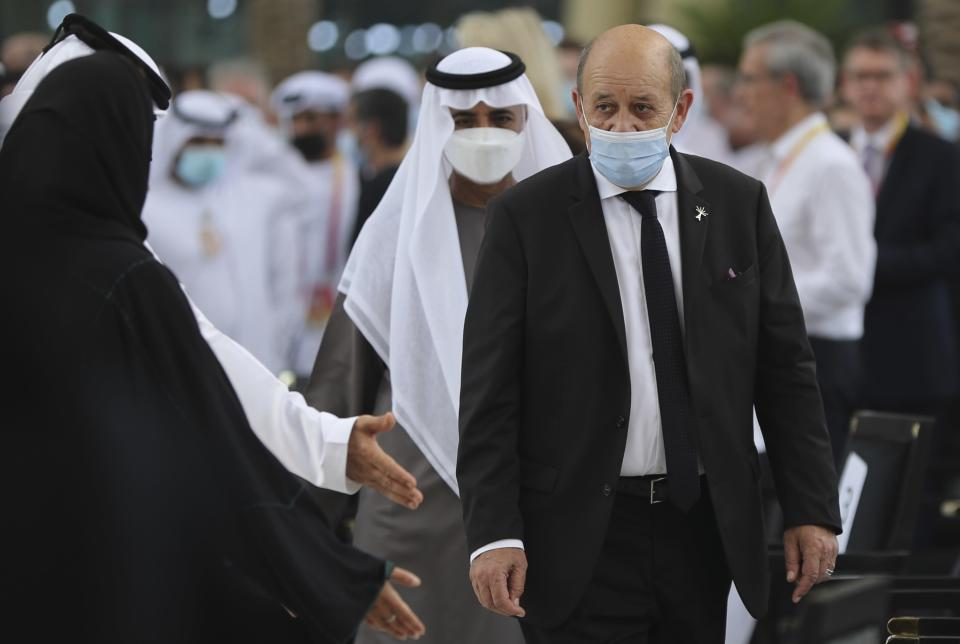 French Foreign Affairs Minister Jean-Yves Le Drian, centre, arrives for an official ceremony at Al Wasl Plaza at the Dubai Expo 2020 in Dubai, United Arab Emirates, Saturday, Oct. 2, 2021. (AP Photo/Kamran Jebreili)