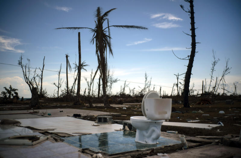 A toilet stands amid the rubble of what was once a home after it was destroyed by Hurricane Dorian one week ago in Pelican Point, Grand Bahama, Bahamas, Sunday, Sept. 8, 2019. The toll from the storm in the Bahamas stood at 44 Monday but officials have warned that the number of deaths is likely to rise as security forces and other teams search devastated areas of the northern Bahamas. (AP Photo/Ramon Espinosa)
