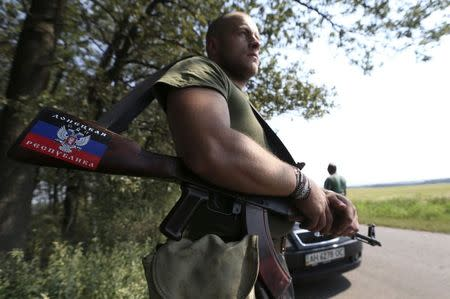 A pro-Russian separatist guards a checkpoint near the village of Rozsypne