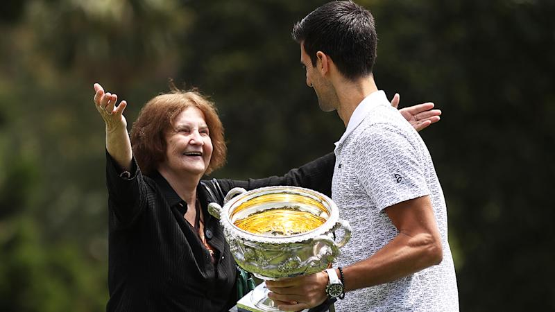 Novak Djokovic photoshoot with the Australian Open trophy was interrupted by 76-year-old Bojana Savic, a Serbian woman who moved to Melbourne when she was 25. (Photo by Clive Brunskill/Getty Images)