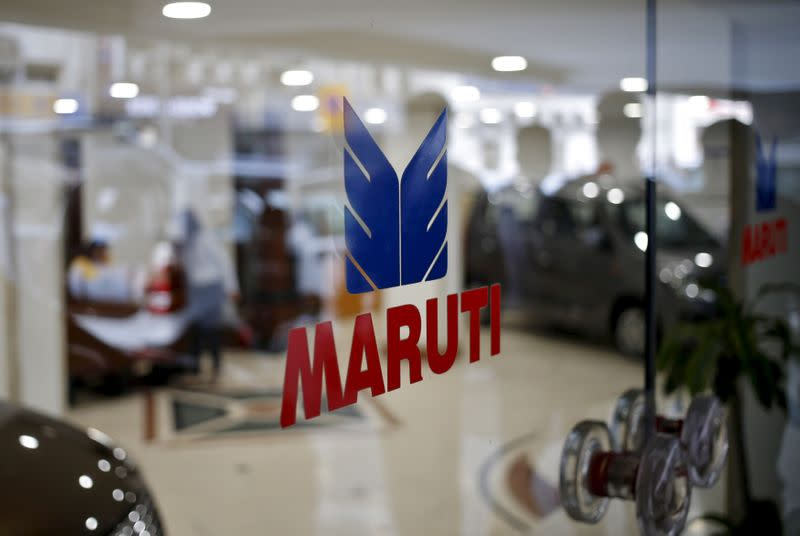 FILE PHOTO: The logo of Maruti Suzuki India Limited is seen on a glass door at a showroom in New Delhi