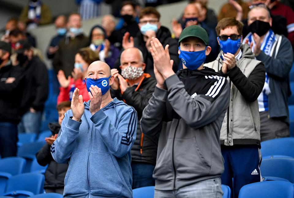 Fans in masks applaud their team (PA) (PA Wire)