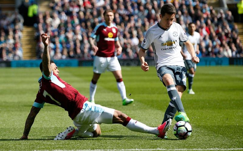 Ander Herrera (R) tries to break clear for Manchester United against Burnley on Sunday - REUTERS