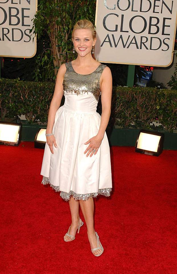 "Reese Witherspoon's two-toned cocktail dress from two years ago was previously worn by Kiki Dunst. Hopefully Reese fired her stylist after learning of the faux pas. Steve Granitz/<a href=""http://www.wireimage.com"" target=""new"">WireImage.com</a> - January 16, 2006"