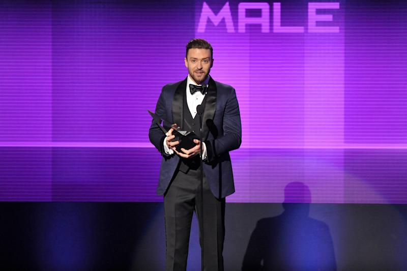 Justin Timberlake accepts the award for favorite male artist - pop/rock at the American Music Awards at the Nokia Theatre L.A. Live on Sunday, Nov. 24, 2013, in Los Angeles. (Photo by John Shearer/Invision/AP)