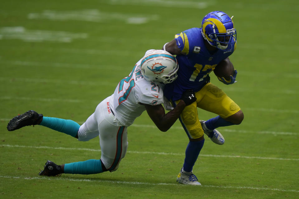 Miami Dolphins free safety Eric Rowe (21) tackles Los Angeles Rams wide receiver Robert Woods (17), during the first half of an NFL football game, Sunday, Nov. 1, 2020, in Miami Gardens, Fla. (AP Photo/Lynne Sladky)