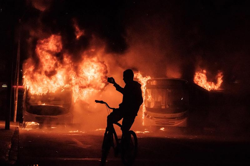 Protesters opposed to austerity-linked reforms took to the streets in Brazil on Friday, clashing with police in some cities. In Rio de Janeiro, demostrators set buses on fire