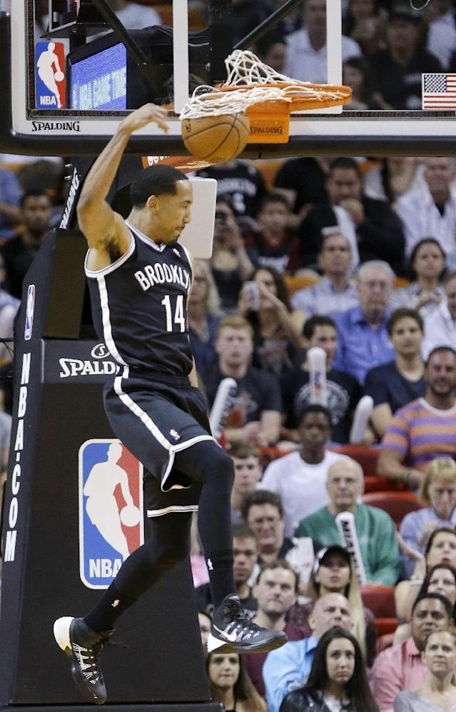 Brooklyn Nets guard Shaun Livingston dunks the ball during the first half of an NBA basketball game against the Miami Heat, Tuesday, April 8, 2014 in Miami. (AP Photo/Wilfredo Lee)
