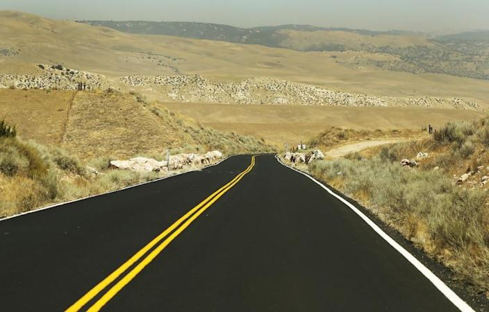 """TEJON RANCH, CA â€"""" AUGUST 06, 2018: A newly paved road in the Oso Drainage Open Space in the flat, windy sprawling grasslands of native and non-native scrub on Tejon Ranch where Centennial, the 12,000 acre proposed master planned community of the ranch off Highway 138, if approved, would bring in up to 19,333 residences, a mix of single-family, multi-family and apartment units, with a business park and open space around their periphery. (Al Seib / Los Angeles Times)"""
