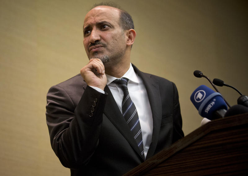 Ahmad al-Jarba, leader of the Syrian National Coalition (SNC), Syria's main political opposition group, rubs his chin during a press conference in Geneva, Switzerland, Thursday, Jan. 23, 2014. Al-Jarba announced that the Syrian peace talk negotiations will be difficult and that Syrian President Bashar al-Assad is now part of the past. (AP Photo/Anja Niedringhaus)