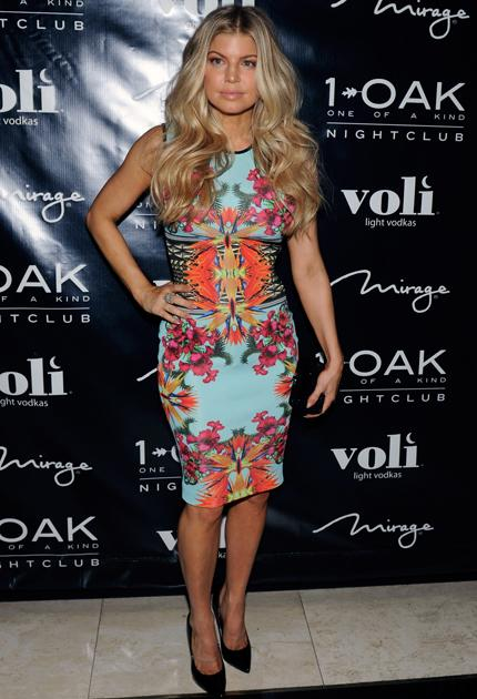 Celebrity fashion: Fergie wore a colour clashing dress to celebrate her birthday in Las Vegas and we're not so sure it works. The pink and orange floral print compete with the bright blue shade, this is one hot mess.