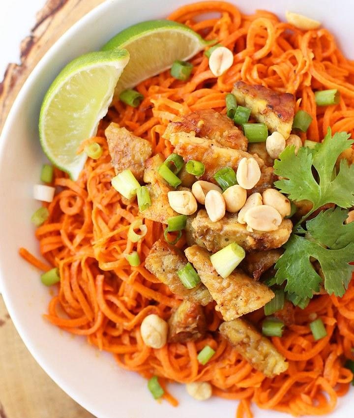 "Swap your Asian-style glass noodles for this spiralized spaghetti for a low-carb option that won't sabotage your weight loss or <a rel=""nofollow"" href=""https://www.eatthis.com/keto-diet-mistakes/?utm_source=yahoo-news&utm_medium=feed&utm_campaign=yahoo-feed"">keto</a> efforts. A slightly spicy and sweet peanut sauce coats the sweet potato noodles and helps soften them up. Top with sliced green onions, roasted peanuts, fresh lime, and cilantro.  <strong>Get the recipe from <a rel=""nofollow"" href=""https://www.mydarlingvegan.com/spiralized-potatoes-noodles/"">My Darling Vegan</a>. </strong>"