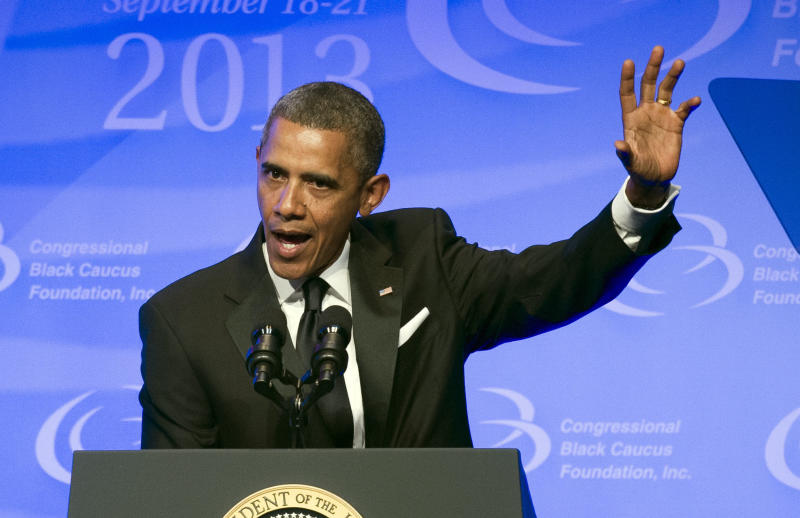 President Barack Obama gestures as he addresses the 43rd annual Congressional Black Caucus Foundation's Legislative Conference dinner in Washington, Saturday, Sept. 21, 2013. (AP Photo/Cliff Owen)