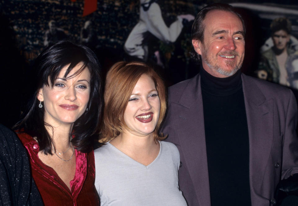 """Courteney Cox, Drew Barrymore and Wes Craven during """"""""Scream"""""""" Memorabilia presentation - December 12, 1996 in New York City, New York, United States. (Photo by Ke.Mazur/WireImage)"""