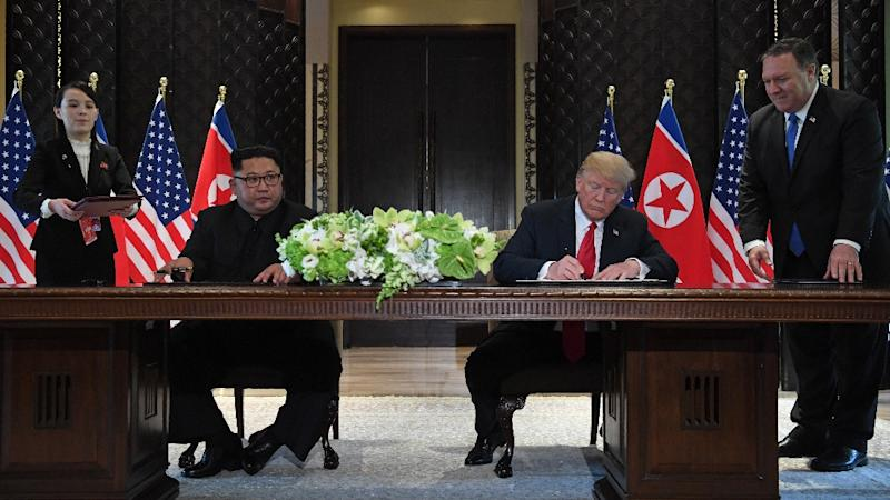 US Secretary of State Mike Pompeo stands by President Donald Trump during his first summit with North Korean leader Kim Jong Un in June 2018 (AFP Photo/SAUL LOEB)