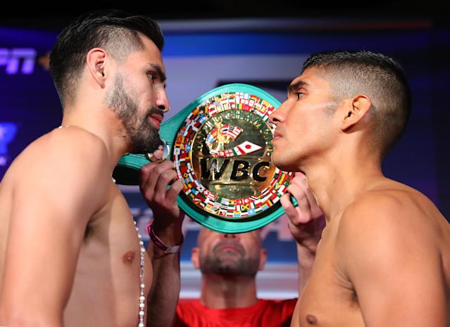WBC super lightweight champion Jose Ramirez (L) stares down Antonio Orozco on Thursday after their weigh-in for Friday night's bout. (Mikey Williams/Top Rank)