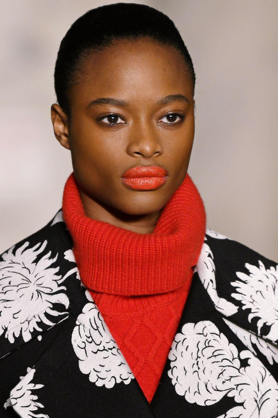 <p>The fall is usually synonymous with brick and wine lipsticks, but at Oscar de la Renta poppy orange-based shades offered a brighter alternative. </p>