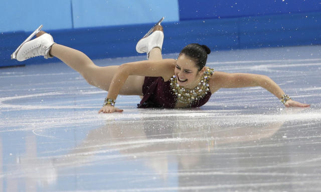 Kaetlyn Osmond of Canada falls as she competes in the women's team free skate figure skating competition at the Iceberg Skating Palace during the 2014 Winter Olympics, Sunday, Feb. 9, 2014, in Sochi, Russia. (AP Photo/David J. Phillip )