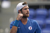 Karen Khachanov, of the Russian Olympic Committee, gestures during a semifinal men's tennis match against Pablo Carreno Busta, of Spain, at the 2020 Summer Olympics, Friday, July 30, 2021, in Tokyo, Japan. (AP Photo/Patrick Semansky)