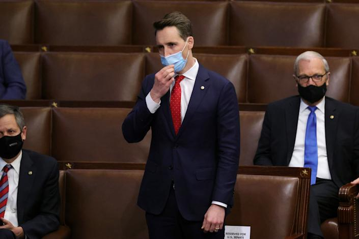 Sen. Josh Hawley (R-Mo.) in the House chamber on Jan. 6. Members returned to chamber after being evacuated when insurrectionists stormed the U.S. Capitol and disrupted a joint session to ratify President-elect Joe Biden's Electoral College win over President Donald Trump. Hawley helped incite the riot. (Photo: Win McNamee via Getty Images)