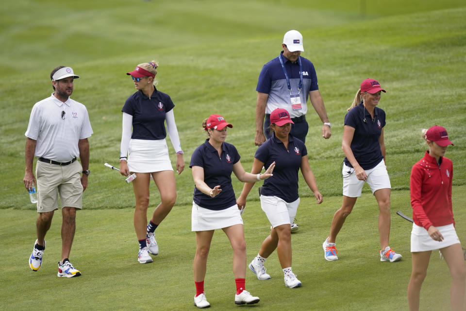From left, Bubba Watson, Jessica Korda, Ally Ewing, Megan Khang, Morgan Pressel and Nelly Korda approach the seventh green during practice for the Solheim Cup golf tournament, Friday, Sept. 3, 2021, in Toledo, Ohio. (AP Photo/Carlos Osorio)