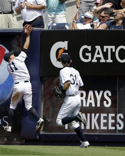 New York Yankees center fielder Brett Gardner (11) and Ichiro Suzuki (31) chase a ball hit by Tampa Bay Rays' Wil Myers for a grand slam during the sixth inning a baseball game Saturday, June 22, 2013, in New York. (AP Photo/Frank Franklin II)