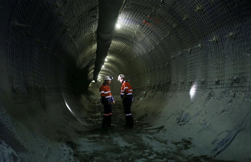 FILE PHOTO: Mine workers are seen at an underground tunnel at the Cullinan mine, outside Pretoria, northeast of Johannesburg